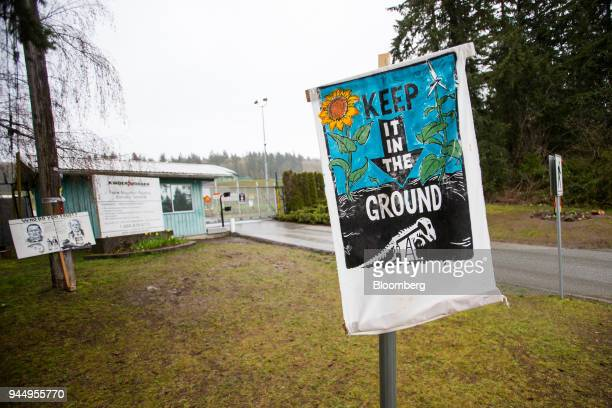 A protest sign stands outside of the Kinder Morgan Inc facility in Burnaby British Columbia Canada on Wednesday April 11 2018 Alberta the landlocked...