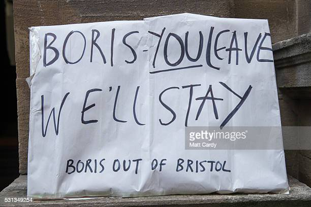 Protest signs are displayed as people queue to listen to Conservative MP Boris Johnson and Conservative MP and former Secretary of State for Defence...