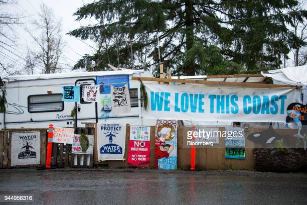 Protest signs are displayed outside of the Kinder Morgan Inc facility in Burnaby British Columbia Canada on Wednesday April 11 2018 Alberta the...