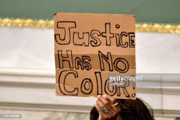 Protest signs go up during public testimony by community members and activists on controversial social media posts by officers of the Philadelphia...