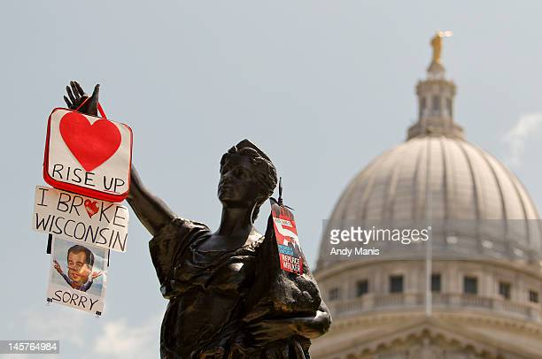 Protest signs hang from the Forward statue in front of the State Capitol June 5 2012 in Madison Wisconsin Milwaukee Mayor Tom Barrett a Democrat is...