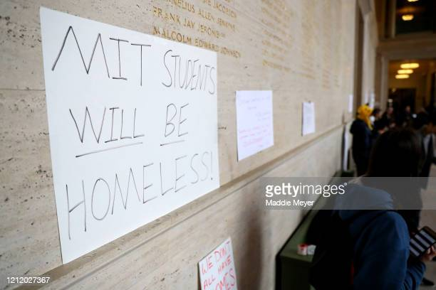 Protest signs hang inside Building 10 on the campus of Massachusetts Institute of Technology on March 12 2020 in Cambridge Massachusetts Students...