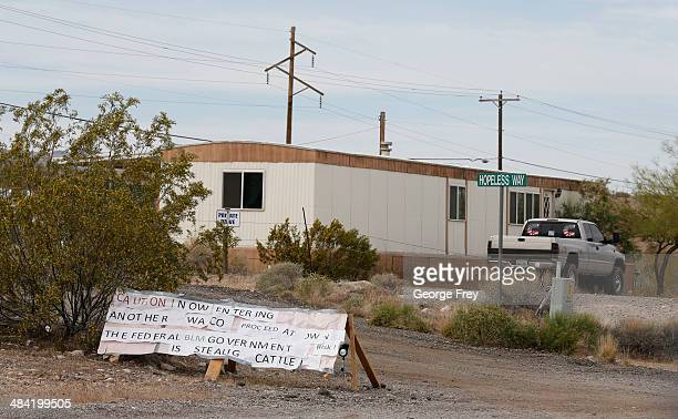 Protest signs sit in front of a trailer along US 170 on April 11 2014 west of Mesquite Nevada Bureau of Land Management officials are rounding up...