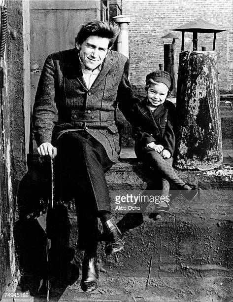 Protest singer Phil Ochs poses for a portrait session with his daughter Meegan Ochs on Bleecker Street in 1965 in New York City New York