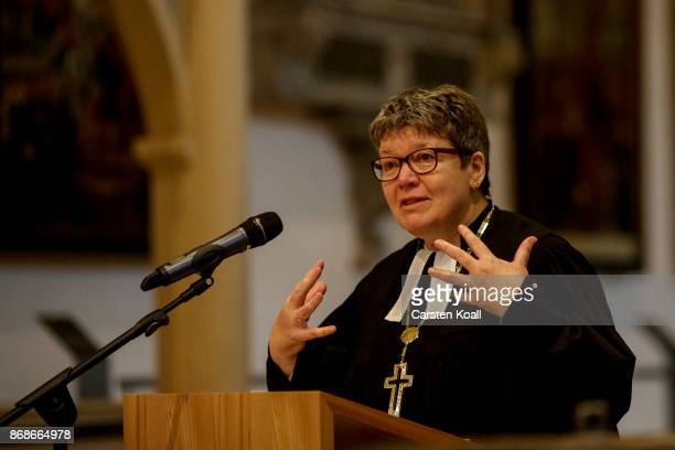 Protestant Bishop Ilse Junkermann preaches during a service in the Stadtkirche Sankt Marien church to commemorate the 500th anniversary of Luther's...