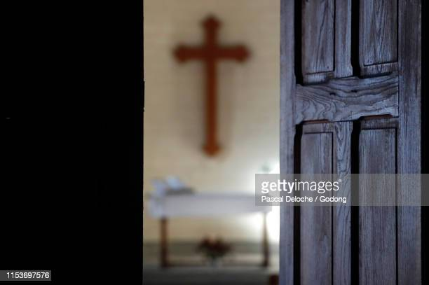 protestant church.  altar and christian cross.  france. - church stock pictures, royalty-free photos & images