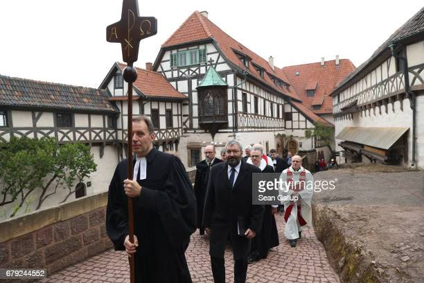 Protestant clergy led by pastor Christian Mueller walk in a procession with a cross to an openair church service at Wartburg Castle to commemorate...