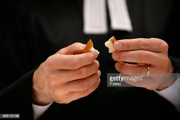 Protestant Minister Breaking Bread
