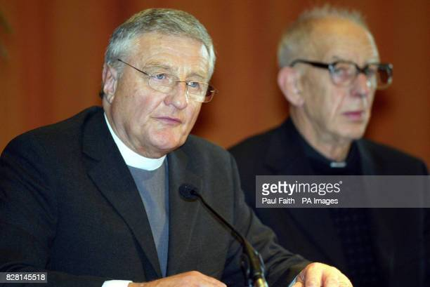 Protestant Minister Rev Harold Good with Catholic Priest Father Alex Reid speaking in Belfast Monday September 26 2005 They acted as independent...