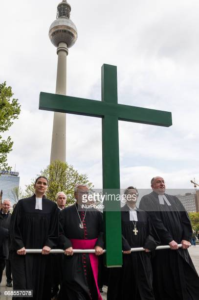 Protestant pastors carry a cross during a procession through the city center to mark Good Friday on April 14 2017 in Berlin Germany Christians across...