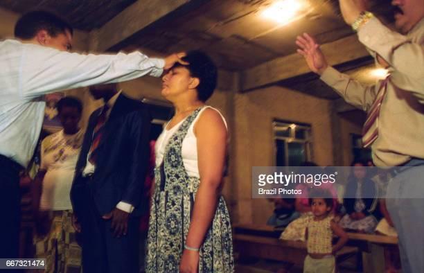 Protestant preacher at a revival meeting in a Pentacostal cult in Favela da Mangueira Rio de Janeiro Brazil