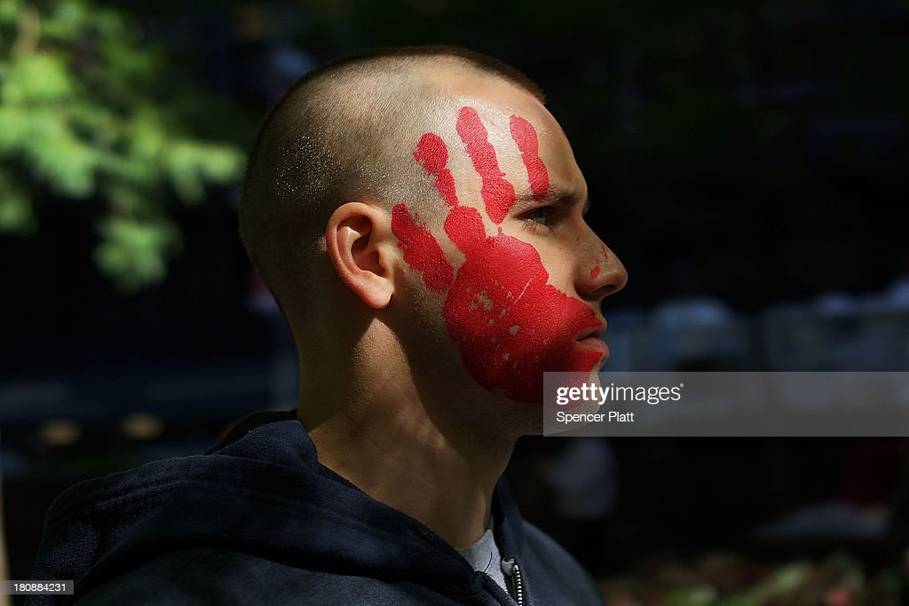 A protester affiliated with Occupy Wall Street demonstrates at Zuccotti Park near the New York Stock Exchange on the second anniversary of the movement on September 17, 2013 in New York City. Numerous rallies and events across the city were planned for the movement which takes aim at inequality and financial greed and which has influenced activist moments around the world. While police presence was high in New York, with a helicopter flying above the park, no incidents had been reported by the afternoon.