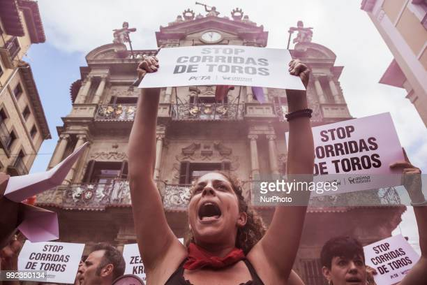 Protester against animal cruelty in bull fightings before San Fermin celebrations shouts under the Pamplona city council building Spain