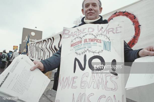 Protester against the Moscow summer Olympics boycott during the Opening Ceremony for the XIII Olympic Winter Games on 14 February 1980 at the Lake...