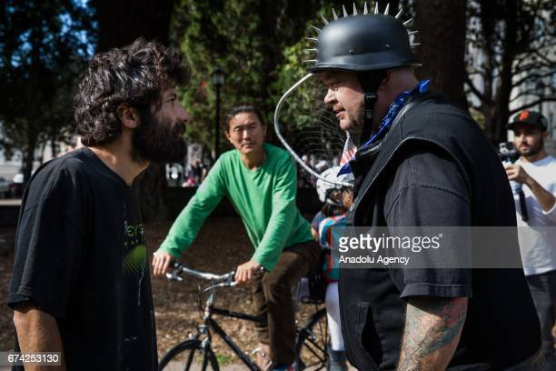 A protester and a Trump Supporter confront each other during a proDonald Trump rally at Martin Luther King Jr Civic Center Park in Berkeley...