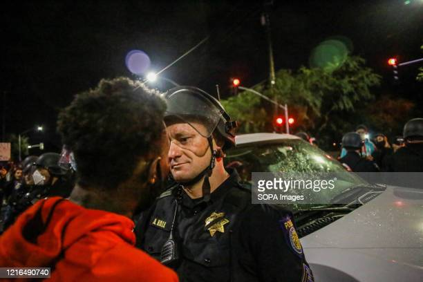 A protester and policeman square off during the demonstration A peaceful protest spurred by the death of George Floyd turned violent as protesters...