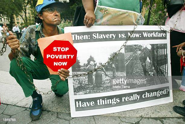 Protester Andy Thomas participates in a demonstration against welfare reform in Union Square August 22, 2002 in New York City. Their protest marked...