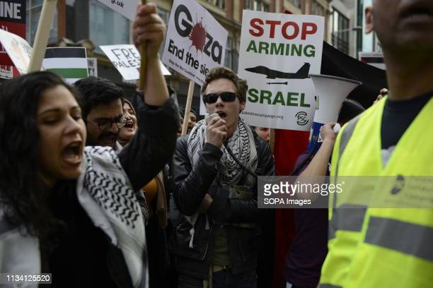 Protester are seen chanting slogans during the Exist Resist Return Rally for Palestine in London People gather outside the Israeli embassy in London...