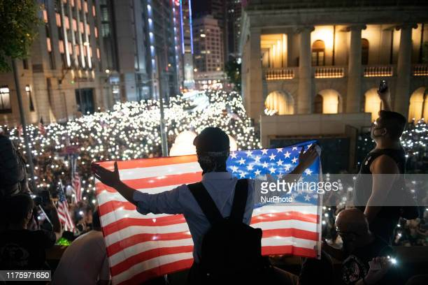 A protester are seen holding up an American Flag during a Rally in Hong Kong China October 14 2019 Protesters gathered in the city's central district...