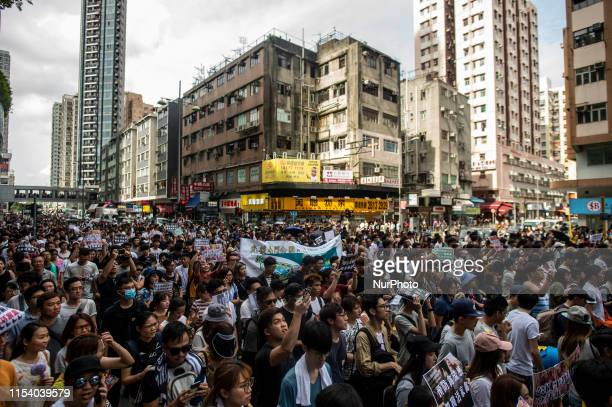 Protester are seen marching in the streets of Tuen Mun in Hong Kong China 6 July 2019 Thousands March Tuen Mun Park in protest of singers singing too...