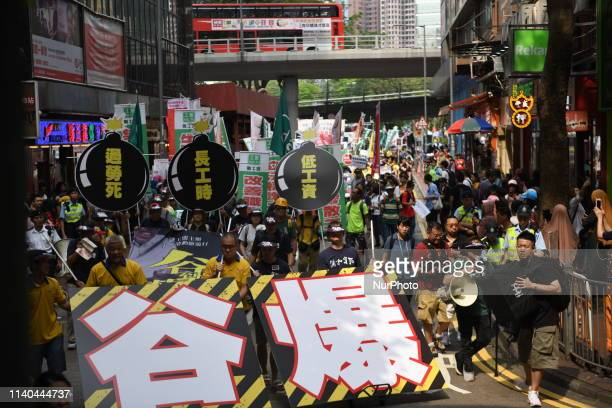 Protester are seen marching on the street during the May Day rally also know as Labor day in Hong Kong China 1 May 2019