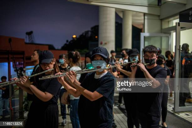 Protester are seen playing the flute in Hong Kong on September 18 protester gather in a Shopping Mall in Kowloon Tong to sing 'Glory to Hong Kongquot...