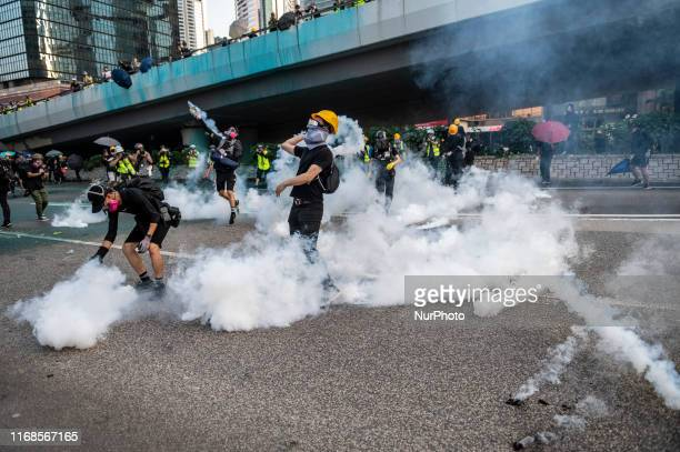 Protester are seen standing in tear gas smoke in Hong Kong on September 15 Protester lady clash with Police with Police firing tear gas and water...