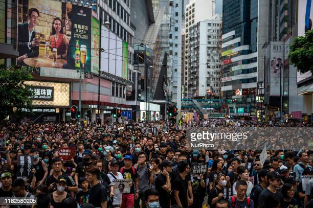 Protester are seen walking down a street in Hong Kong on August 18 Tens of Thousands take to the streets of Hong Kong in a rally in Victoria Park...