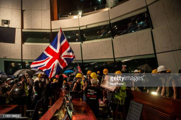 Protester are seen waving a UK flag inside the Chamber of Legco in Hong Kong China 1 July 2019 Thousands of protesters storm the Legislative Council...