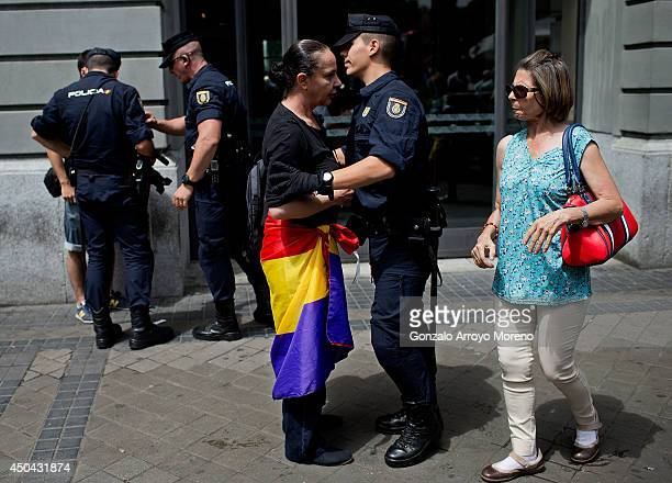 Protester argue with police as they are removed from Canovas del Castillo square during a protest calling for a Referenderum surrounding the Spnish...