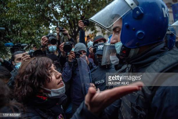 Protester argues and gestures to a Turkish policeman during a demonstration against Turkey's withdrawal from Istanbul Convention, an international...