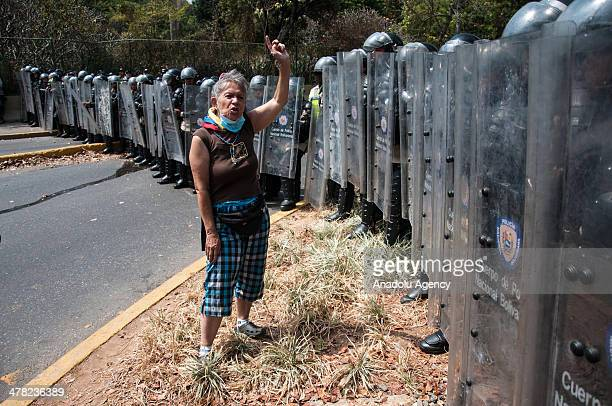 A protester argues with National Bolivarian Guard members during the antigovernment protests in Caracas Venezuela on March 12 2014 Three people...