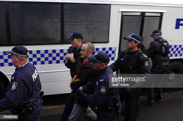 Protester arrested after scuffle with police during an antiwar protest close to the Asia Pacific Economic Cooperation forum at the All People For...