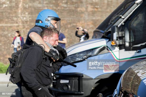 A protester arrested by the police officer Hundreds of protesters are met in Lucca to show their disapproval for the G7 meeting the meeting of...