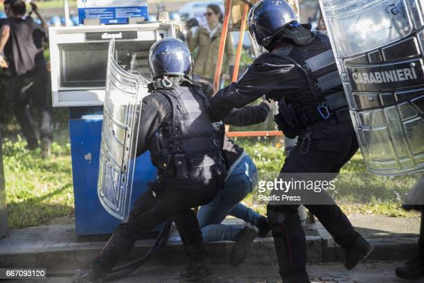 A protester arrested by the police officers Hundreds of protesters are met in Lucca to show their disapproval for the G7 meeting the meeting of...