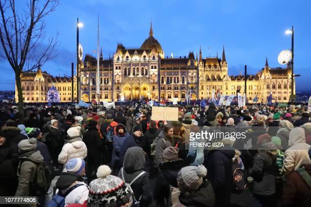 Protester arrive the Kossuth square of the parliament building during a demonstration against the government's new labour reform dubbed the slave law...