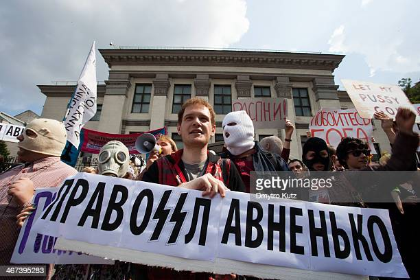 Protester at the demonstration in support for Pussy Riot near the Russian embassy in Kiev, Ukraine holding the slogan comparing modern Russian...