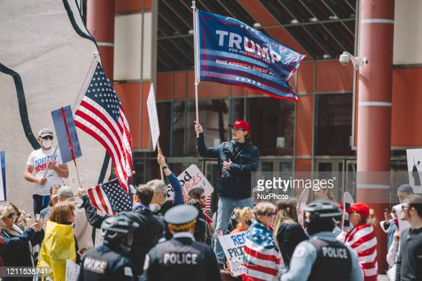 Protester at the ReOpen Illinois gathering outside the Thompson Center in Chicago IL during protest restrictions instituted by the governor to...