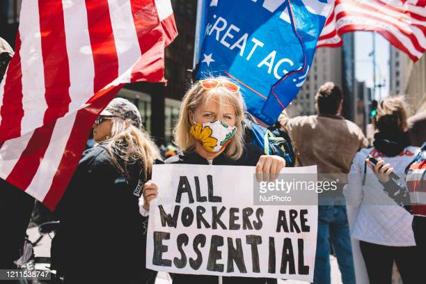 Protester at the Re-Open Illinois gathering outside the Thompson Center in Chicago IL during protest restrictions instituted by the governor to...