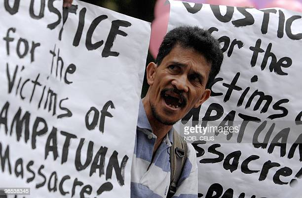 A protester attends a protest demanding justice for 57 Amputuan massacre victims in Maguindanao during a rally in front of the Department of Justice...