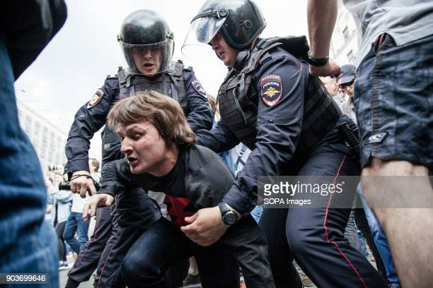 A protester being arrested by the police Anticorruption protest organised by opposition leader Alexei Navalny at Tverskaya Street