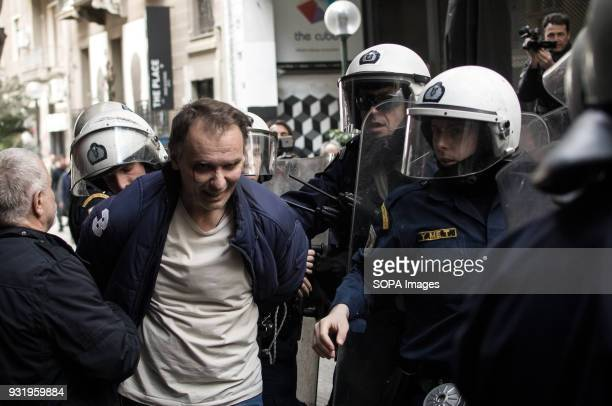 A protester being arrested by the police seen during a demonstration against property foreclosure auctions