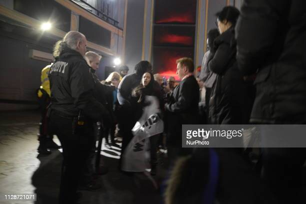 A protester being carried away after she was yelling and questioning Prime Minister Justin Trudeau and leader of the Liberal Party of Canada during a...