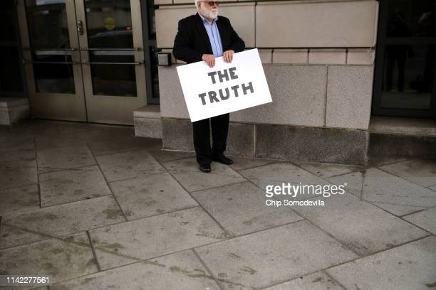 Protester Bill Christeson waits for Greg Craig former White House counsel under former US President Barack Obama to leave the US District Court...