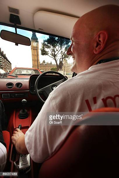 Protester Bob Hills drives in a convoy of Vauxhall cars around Parliament Square in Westminster in a campaign to safeguard workers' jobs on July 15...