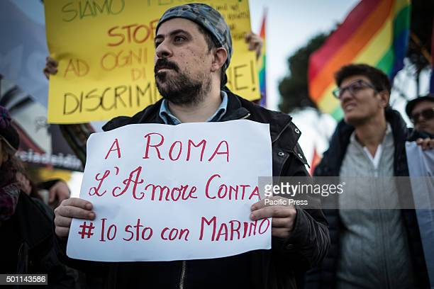 Protester bring placard during the 'March of the rights' to break the silence on the rights of at least three million citizens from lesbian gay...