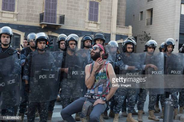 Protester brushes his beard as anti-government demonstrators block a highway on November 4, 2019 in Beirut, Lebanon. Demonstrators cut roads around...