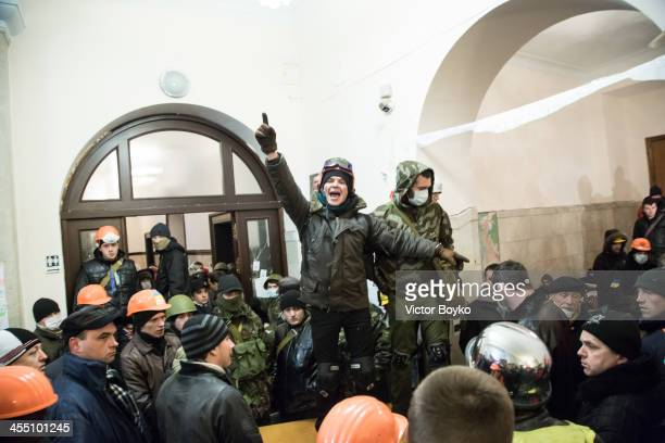 A protester calls for attention inside the City Hall after the riot police were forced out from blocking the front door as authorities launched an...