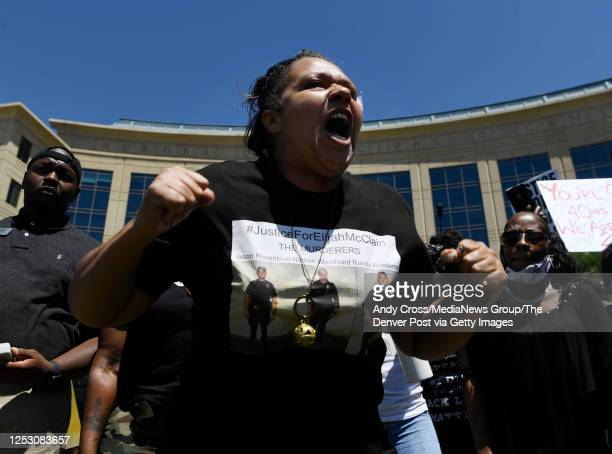 Protester Candace Bailey yells and voices her concerns during an Elijah McClain rally at the Aurora Municipal Center June 27 2020 Elijah McClain died...