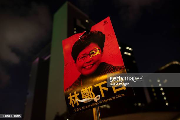 A protester caries a banner against the Chief Executive of Hong Kong Carrie Lam during the demonstration Despite the Chief Executive Carrie Lam's...